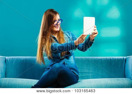 Girl Using Tablet Taking Picture Of Herself Blue Color