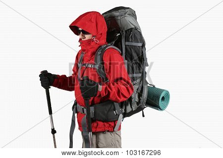Tourist In Red Jacket With Backpack And Trekking Sticks