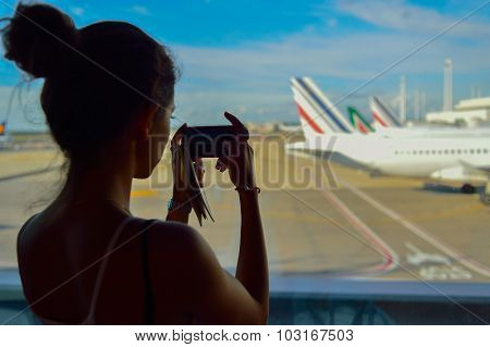 ROME, ITALY - AUGUST 16, 2015: woman take a photo of Fiumicino Airport. Fiumicino - Leonardo da Vinci International Airport is a major international airport in Rome, Italy