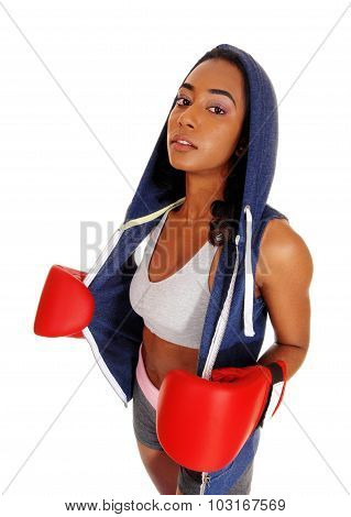Athletic Woman In Hoody Wearing Boxing Gloves.