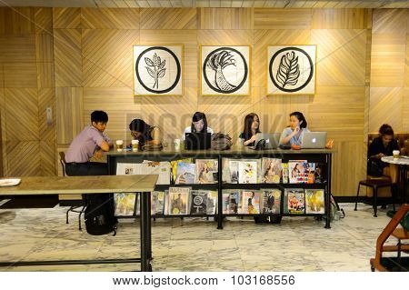HONG KONG - MAY 05, 2015: Starbucks cafe customers. Starbucks is the largest coffeehouse company in the world, with more then 23000 stores