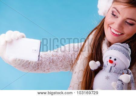 Woman With Little Snowman Taking Selfie Photo.