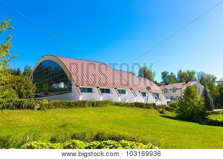 Building with spherical roof
