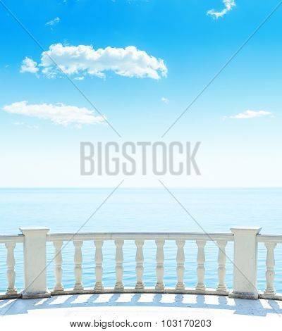 balcony near sea and blue sky with clouds