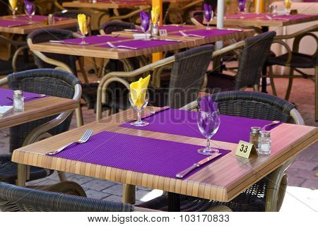 Restaurant Table With Purple Placemat