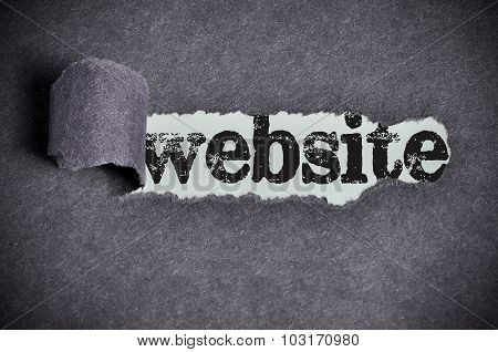 Website Word Under Torn Black Sugar Paper