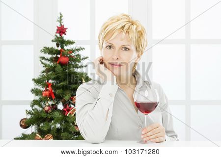 Successful forty years woman, wine and christmas celebration