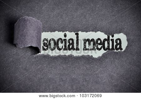 Social Media Word Under Torn Black Sugar Paper