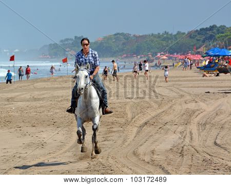 Young Woman Riding A Horse On Legian Beach