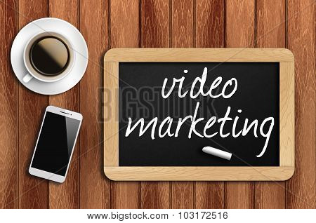 Coffee, Phone And Chalkboard With Video Marketing Words