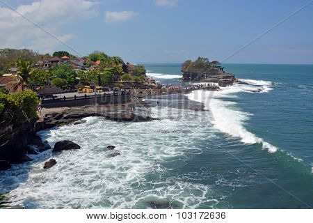 Tanah Lot Temple On Rock At High Tide With Tourists