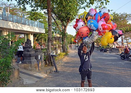 Young Vendor Of Animal Shaped Balloons At Legian Beach