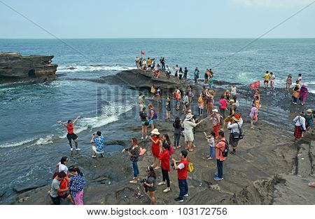 Visitors At Tanah Lot Temple Taking Photos, Bali