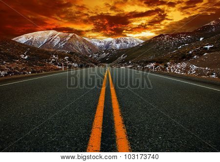 Beautiful Sun Rising Sky With Asphalt Highways Road Against  Snow Mountain Scenery Background In Ne