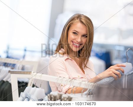 Smiling girl in the store
