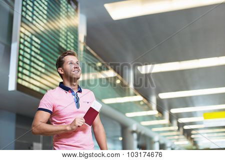 Man with a passport at the airport