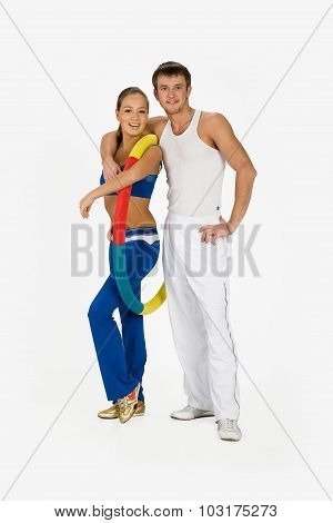Young Woman And Man With Training Device