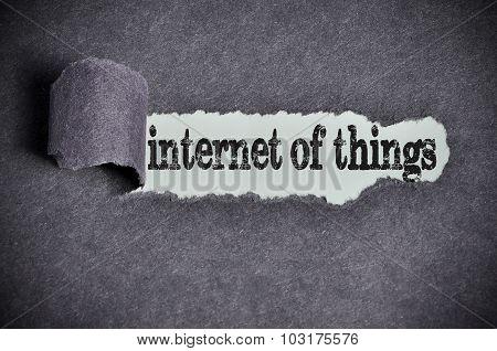 Internet Of Things Word Under Torn Black Sugar Paper