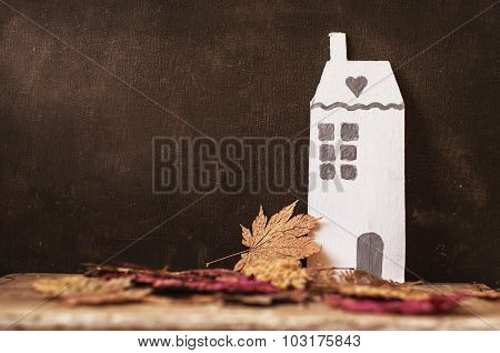 Alone Cardboard House And Dry Leaves