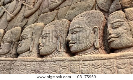 Stone Faces Of Khmer Warriors
