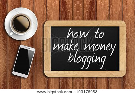 Coffee, Phone And Chalkboard With How To Make Money Blogging Words
