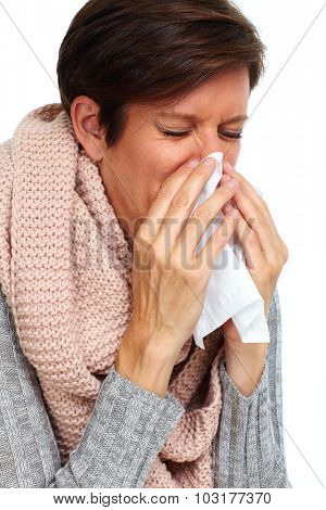 Woman with facial tissue having rheum. Health care.