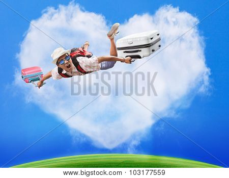 traveling man flying over blue sky and white heart shape cloud background