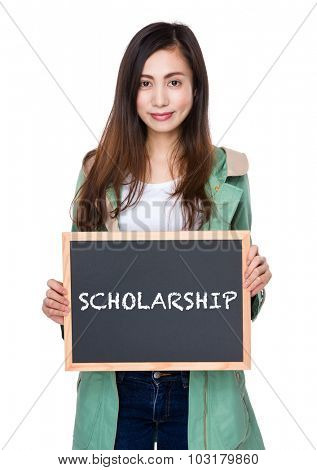 Woman hold with blackboard showing a word scholarship