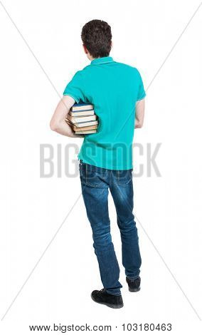 A man carries a heavy pile of books. back view. Rear view people collection.  backside view of person.  Isolated over white background. Man holding a heavy stack of books under his right armpit.