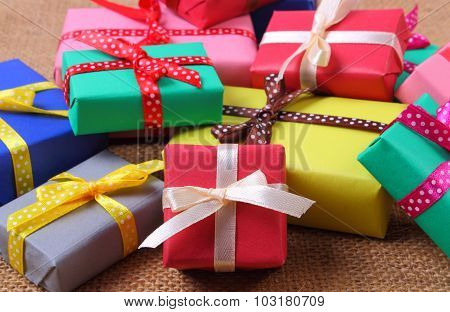 Heap Of Wrapped Gifts For Christmas Or Other Celebration On Jute Canvas