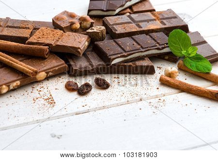 variety of chocolate on a wooden background with space for text