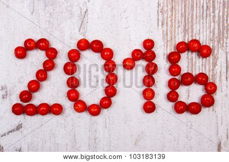 Happy New Year 2016 Made Of Red Viburnum On Old Wooden Background
