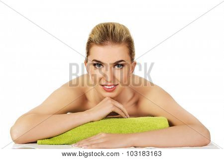 Smile beautiful young woman relaxing in spa.