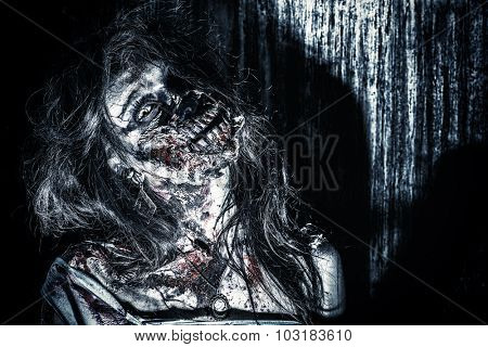 Close-up portrait of a scary bloody zombie girl. Horror. Halloween.