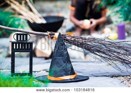 Halloween accessories: hat, broom, candle, garlic and flashlights