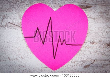 Heart Of Paper With Cardiogram Line On Wooden Background, Medicine And Healthcare Concept