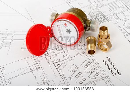 Red water meter with fitting pieces on draft