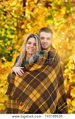 Falling in love autumn. smiling couple portrait