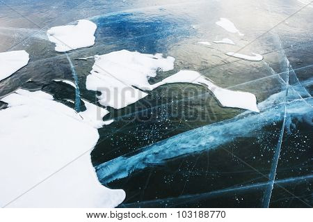Blue Ice With Cracks On The Lake.
