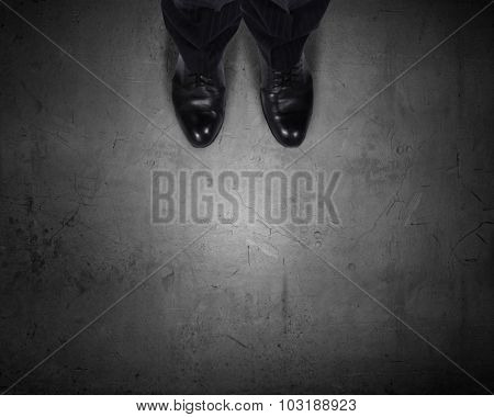 Top view of businessman legs choosing his way