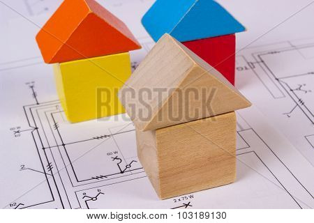 Houses Of Wooden Blocks On Construction Drawing Of House, Building House Concept
