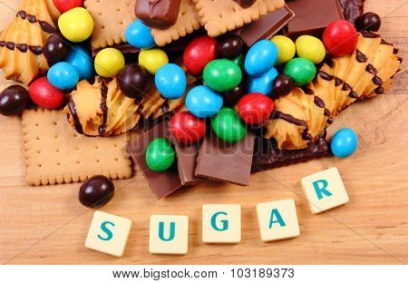 A Lot Of Sweets With Word Sugar On Wooden Surface, Unhealthy Food