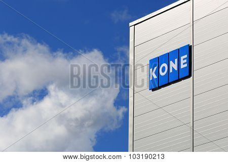 KONE Building With Signage And Blue Sky Clouds
