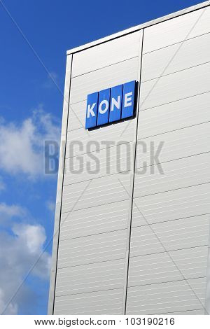 Kone Building With Signage And Blue Sky Clouds, Vertical