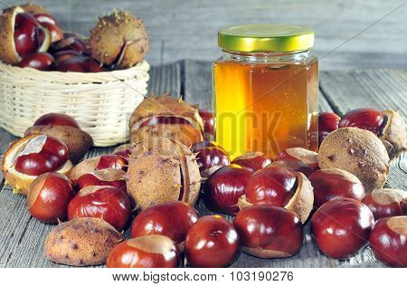 Horse Chestnut And Honey On A Wooden Table