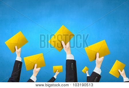 Crowd of businesspeople lifting up hands with email signs
