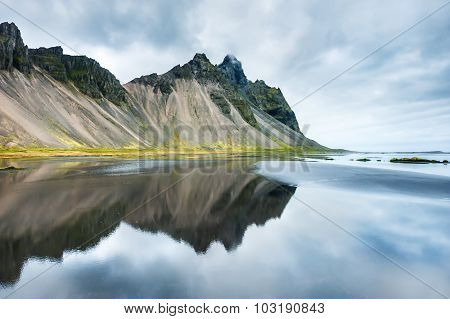 Mountains And Reflection On The Coast Of The Atlantic Ocean