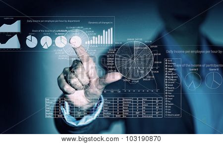 Portrait of businesswoman touching virtual panel with finger