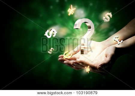 Hands holding money currency signs in palm