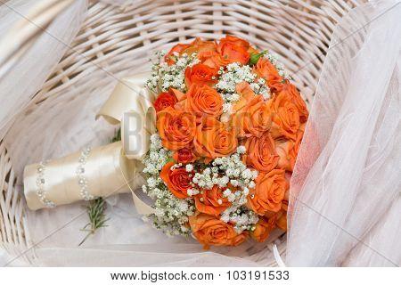 Wedding bouquet in wicker basket